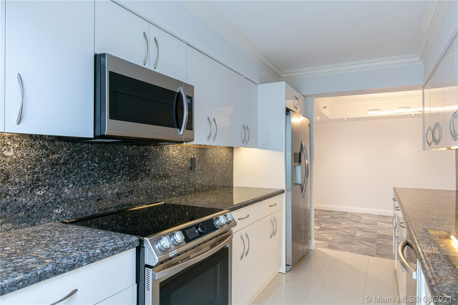 Best line in the building! Beautifully updated and huge 2 bedroom, 2 bath corner unit with a massive