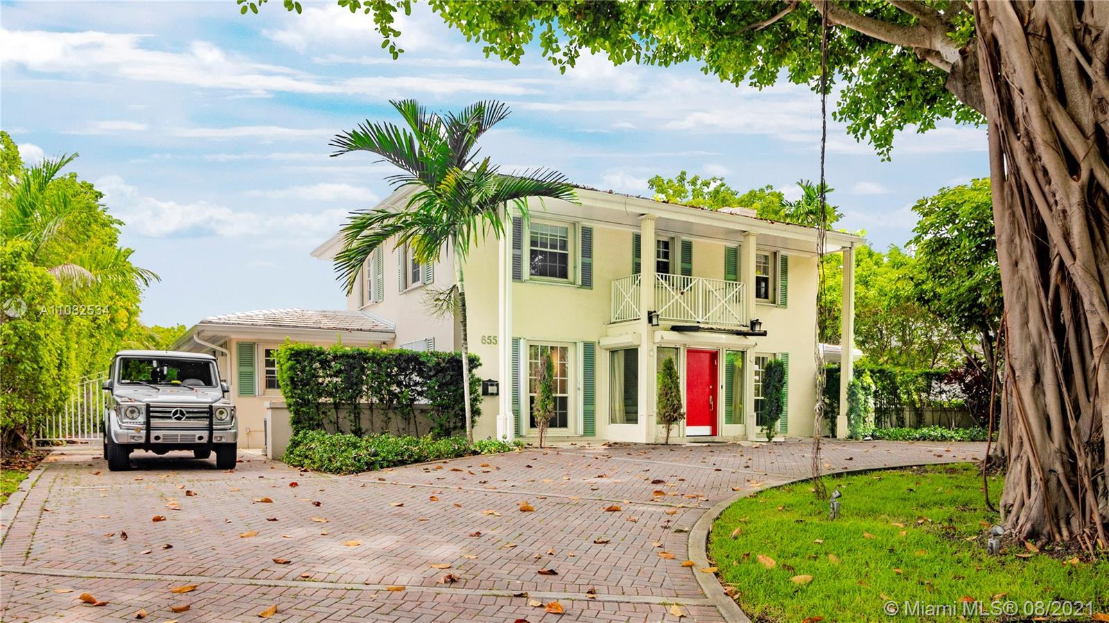 Welcome to 655 Buttonwood Lane, a gorgeous 13,590 SF estate located on the north side of gated Bay P