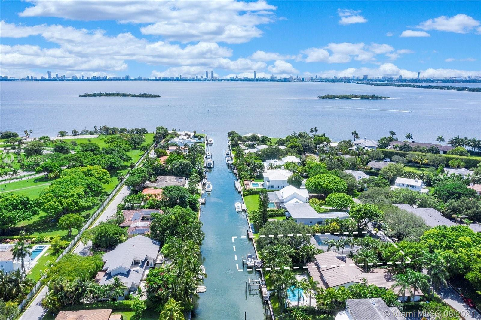 ONE-OF-A KIND ESTATE WITH 88 FEET OF WATERFRONT AND UNOBSTRUCTED BISCAYNE BAY ACCESS LOCATED IN EXCL
