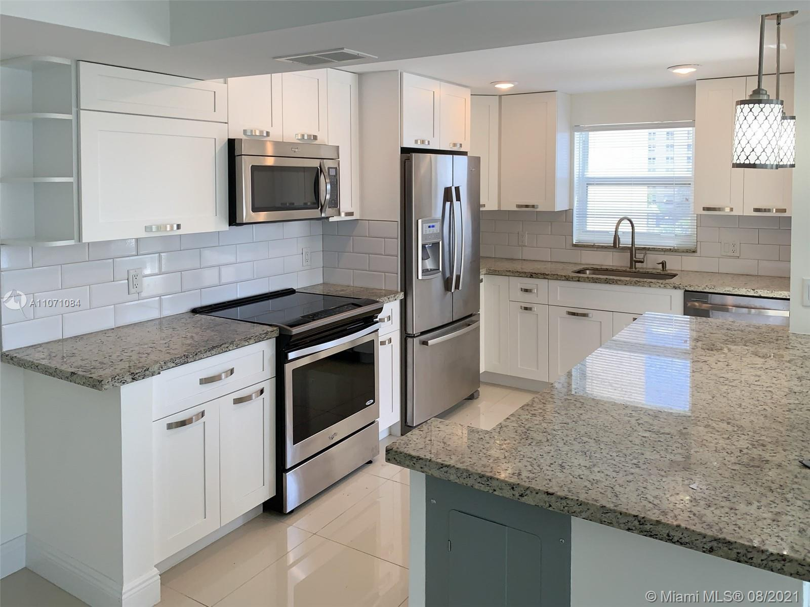 Magnificently renovated modern 2/2 unit across the street from the OCEAN! Corner unit that is light