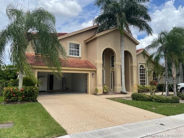Large Boca Falls Home for sale! 5 bed / 3.5 bathrooms with high ceilings. Master Bedroom and one bed