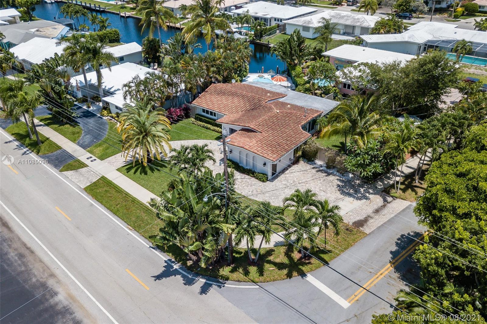 """A beautifully updated waterfront home in highly coveted """"Imperial Point! """"Spacious living and formal"""