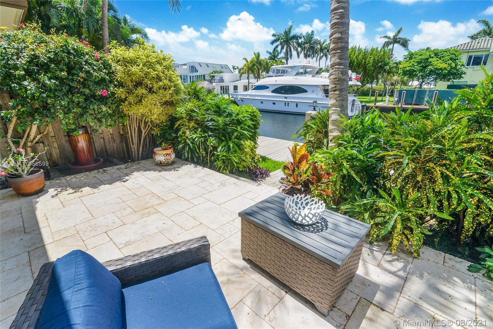 Elegant Waterfront Fee-simple Townhome, on Deepwater canal with stunning views of Intracoastal & Bir