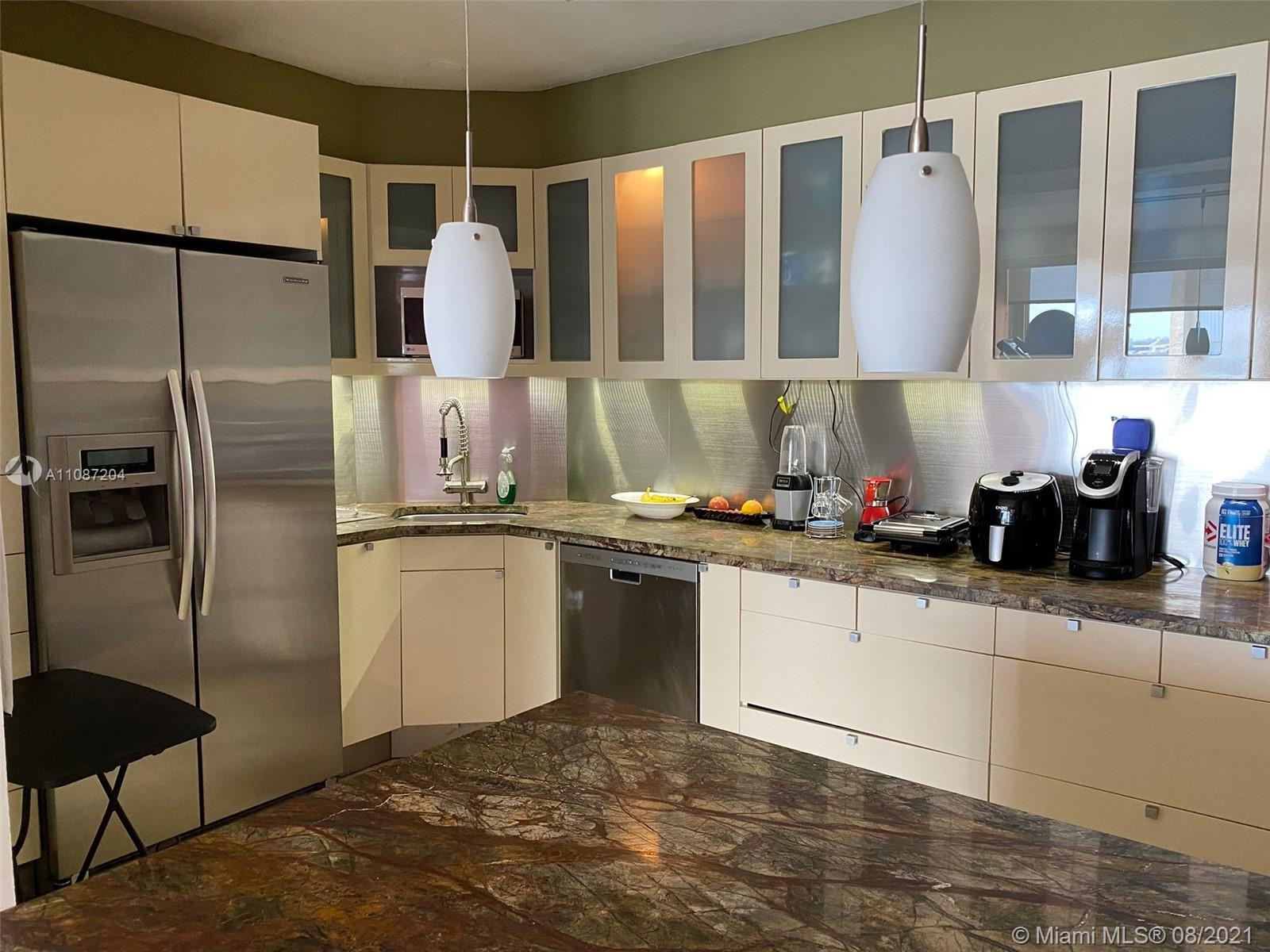 Beautiful unit remodeled with UNOBSTRUCTED BAY VIEW on prestigious Brickell bay drive. Modern kitche