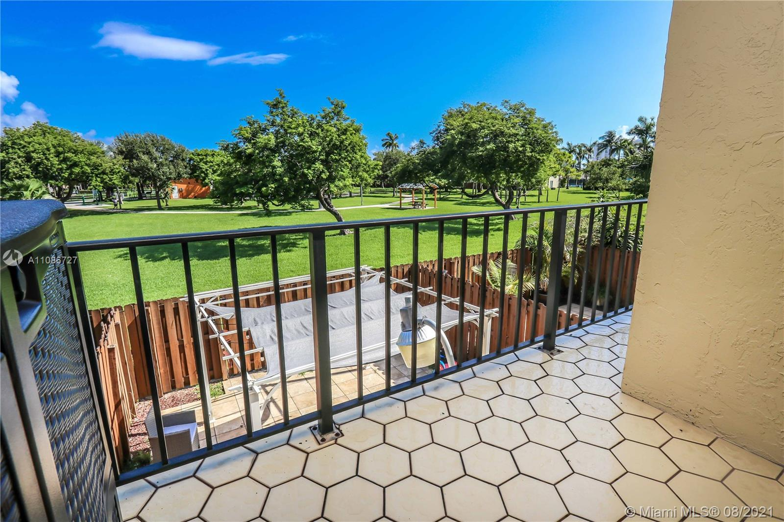 UNIQUE LOCATION 2BD / 2.5 BA PLUS DEN, TWO STORY TOWNHOME WITH PATIO GATE OPENING TO THE 7 ACRE BEAU