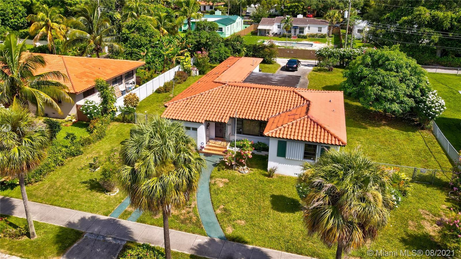 FANTASTIC MIAMI SHORES FAMILY HOME! THIS SPACIOUS 3/2 + OFFICE/DEN IS SITUATED ON HUGE DOUBLE LOT WI