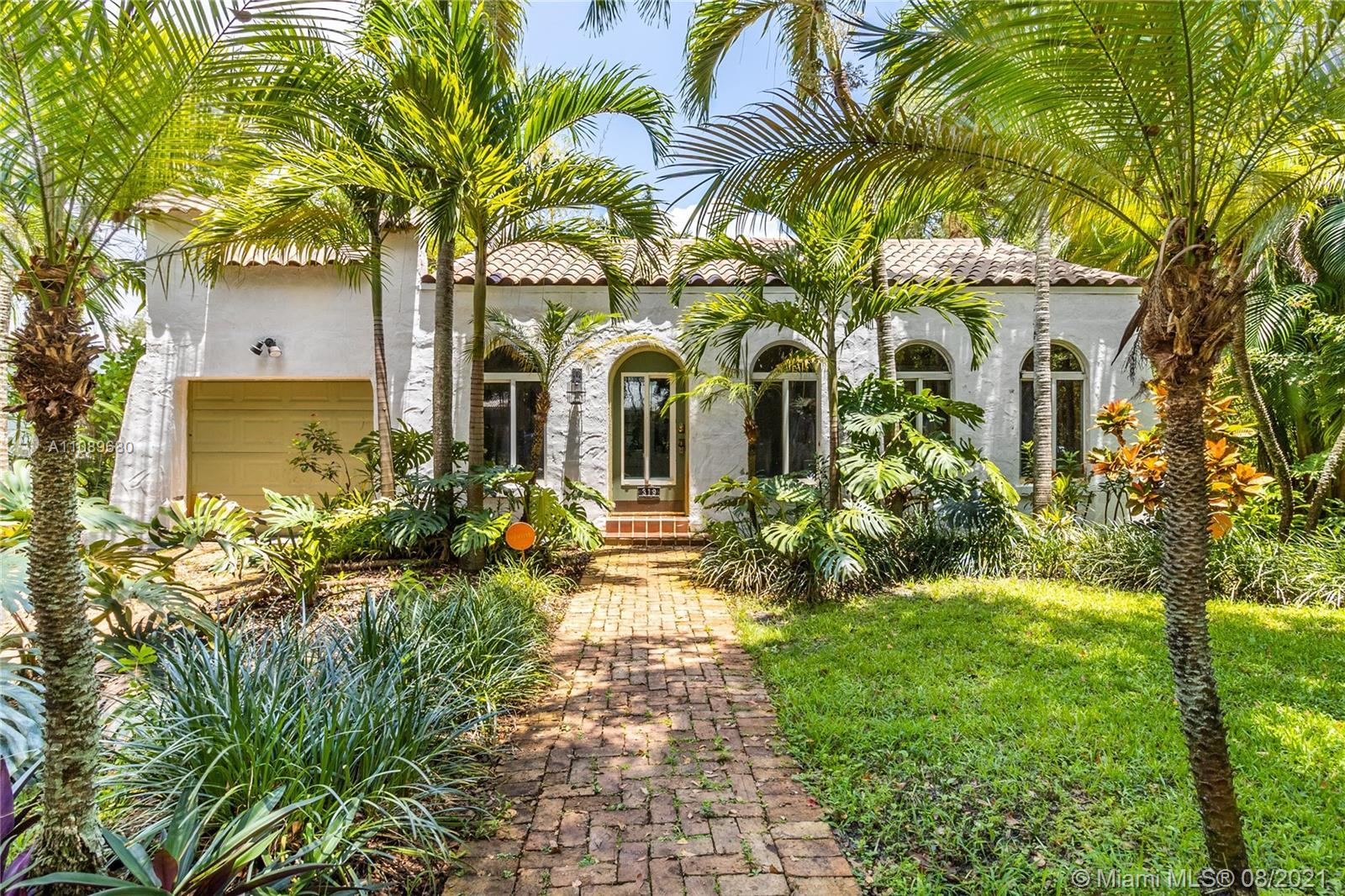 Spectacular botanical paradise in the heart of Miami Shores. This majestic property just received an