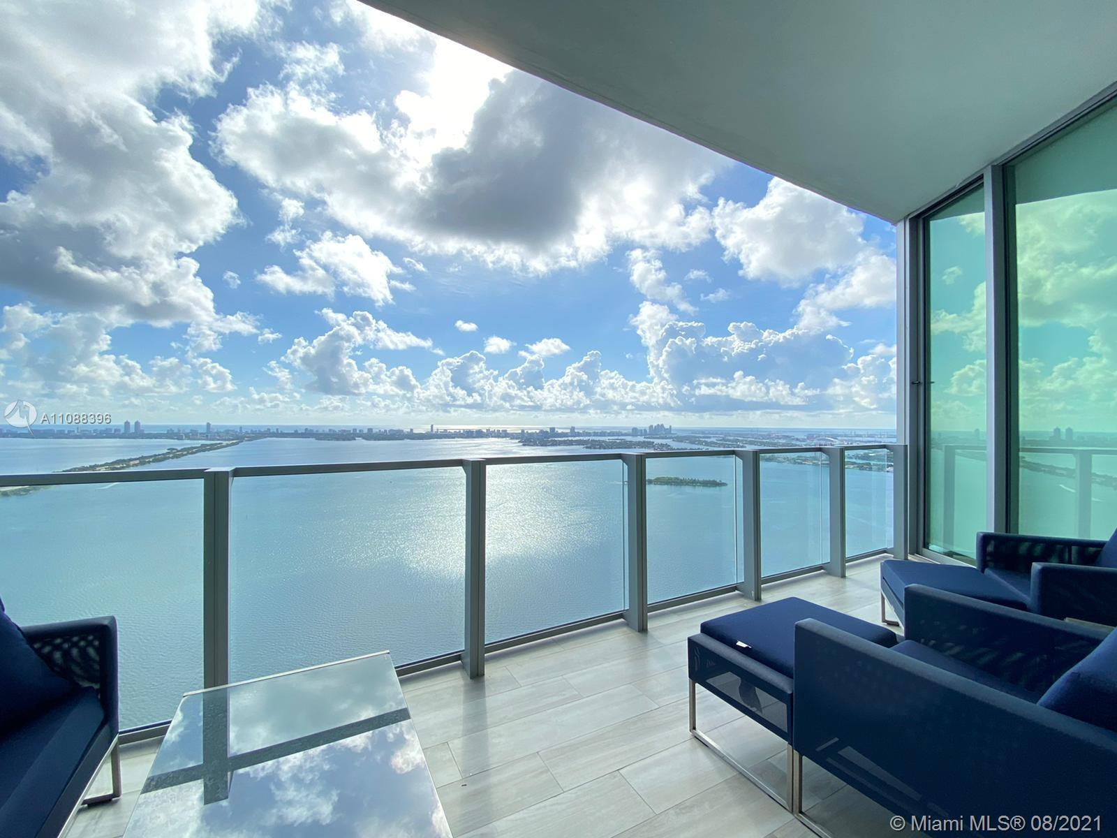 This bright water-front residence, located in Edgewater, features unobstructed Biscayne Bay and Miam