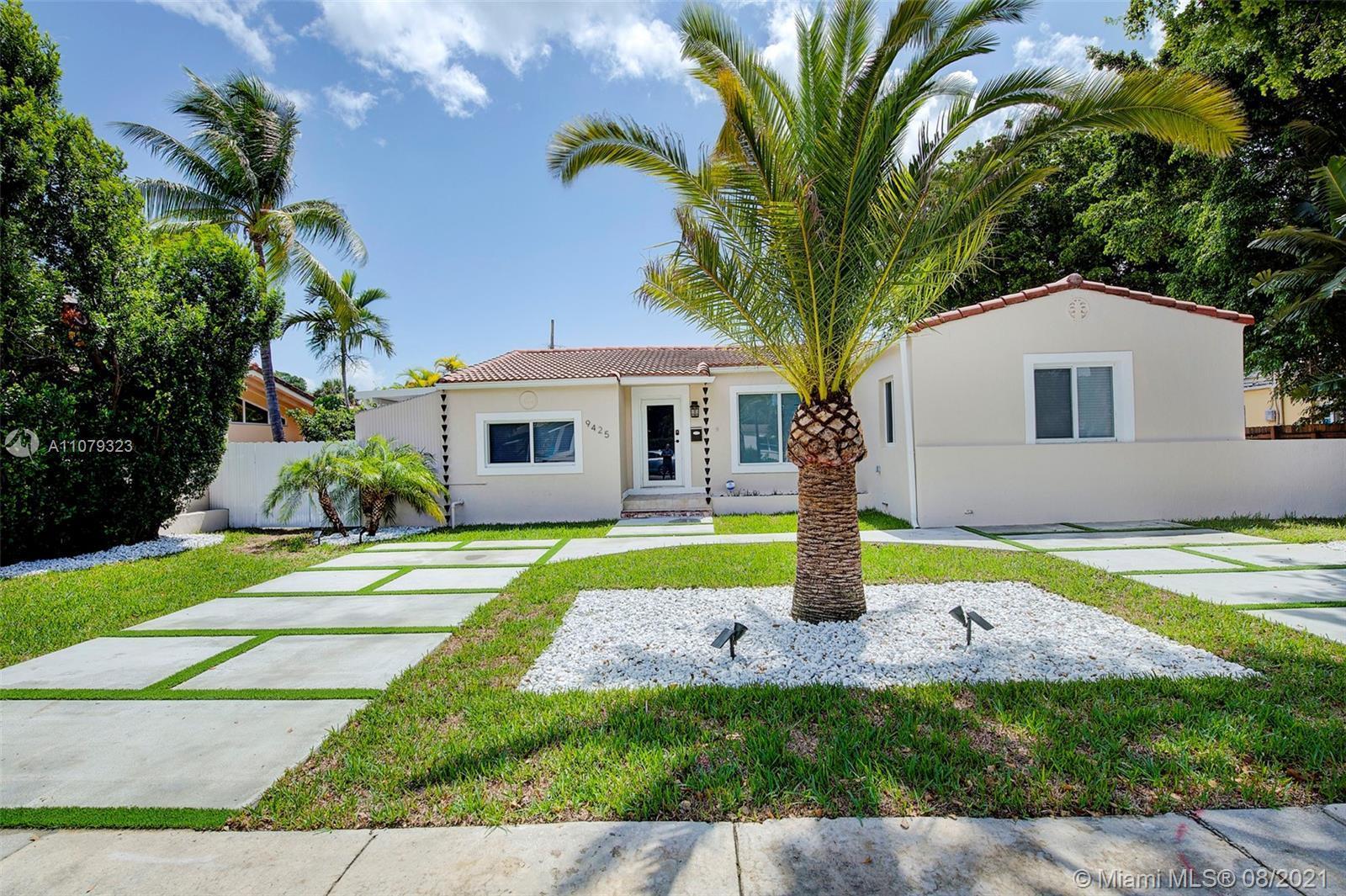 Miami Shores living at its best in this bigger than tax roll 3/2 plus bonus room under air! Surround