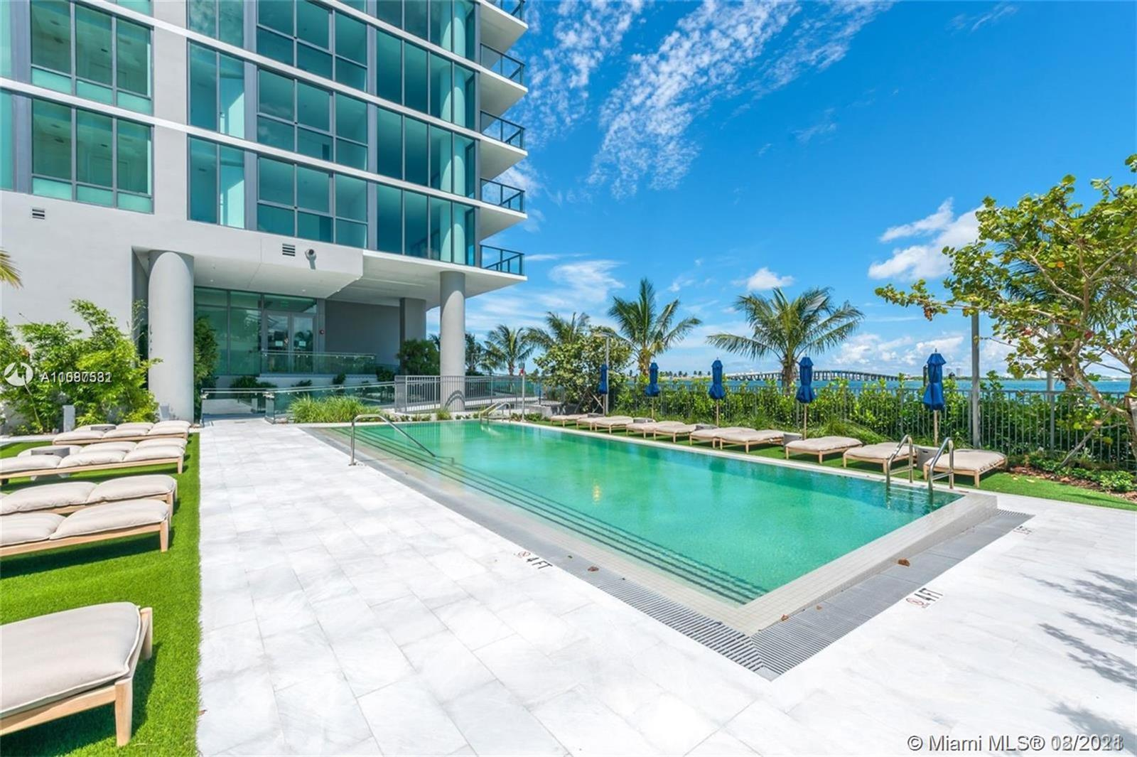 Amazing 2 bed 2 bath unit with private elevator. white calacatta marble flooring.  electrical shades