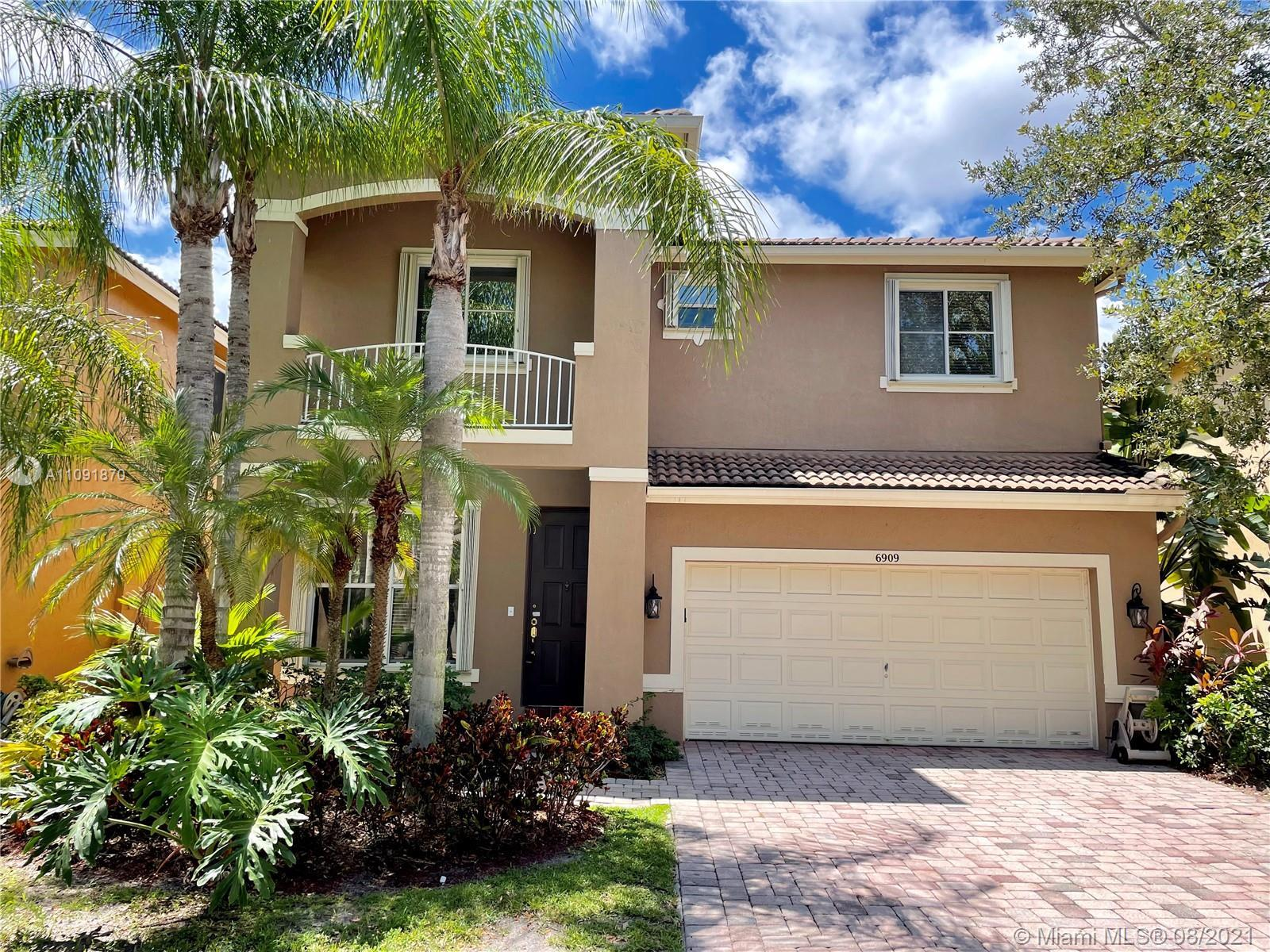 JUST REDUCED! Amazing opportunity to live in the highly desirable community of Cocoplum! This 2 stor