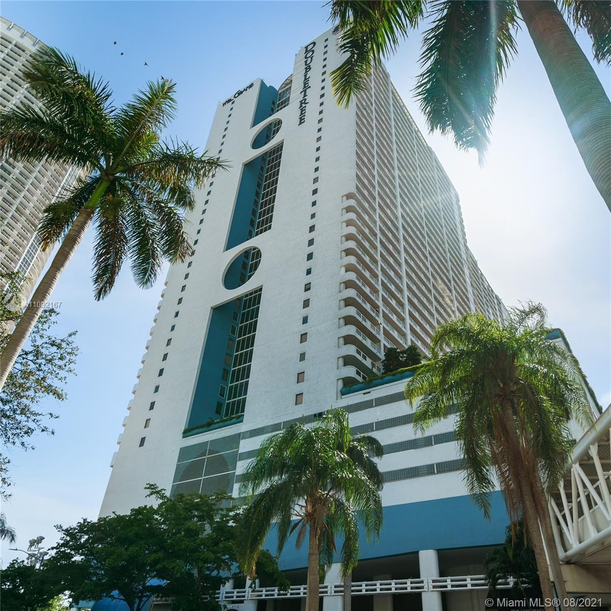 Beautiful corner unit at The Grand with stunning views of Biscayne Bay and Miami Skyline. Excellent