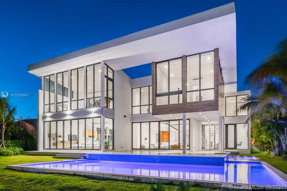 This architectural marvel is located in exclusive gated Golden Isles, home features 6 bedrooms and 6