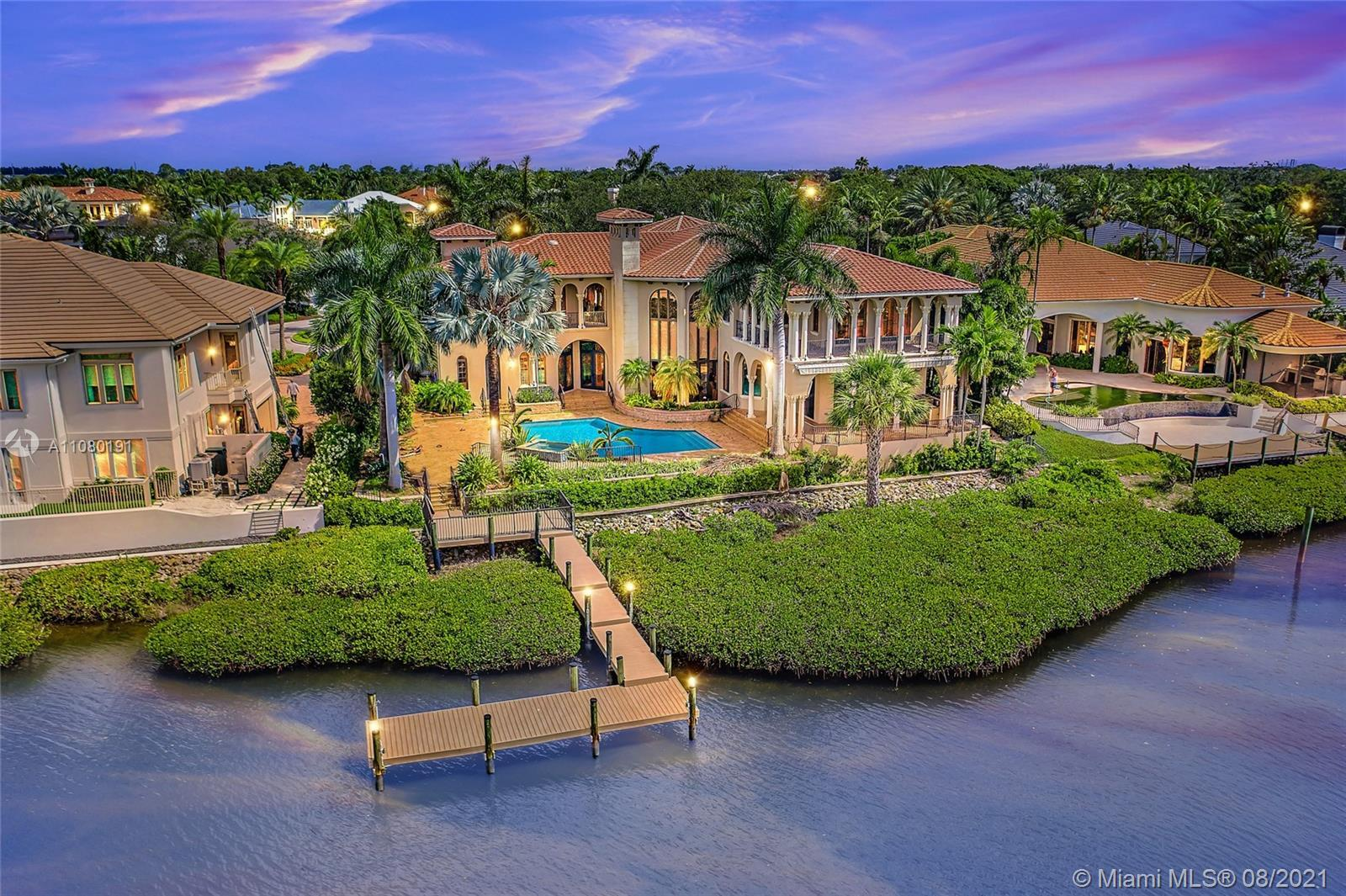 Waterfront Estate home with over 8,100 square feet of luxury living. Located on a tree lined, cul-de