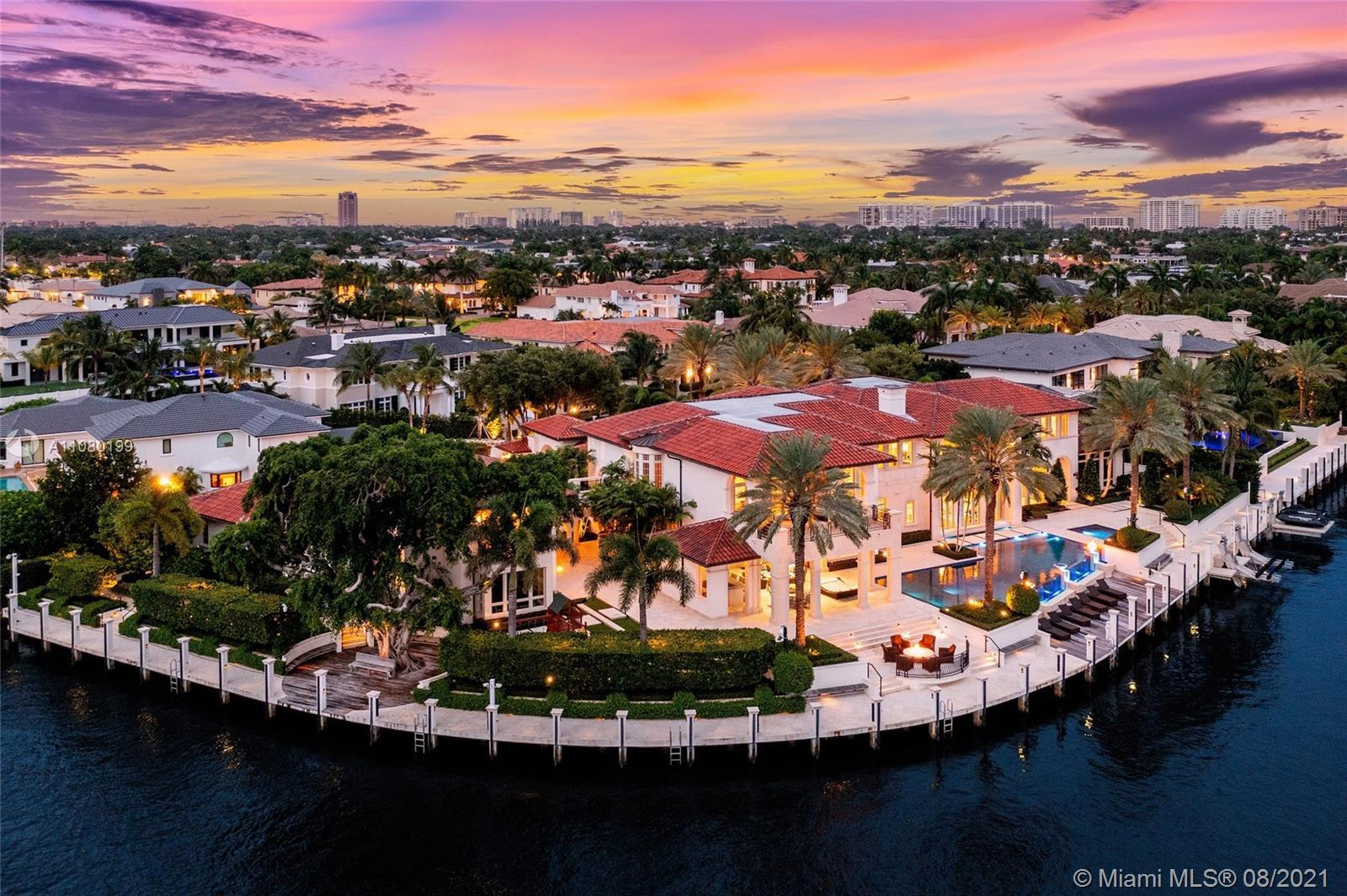 Step inside this one of a kind waterfront point lot located in Royal Palm Yacht & Country Club. Situ