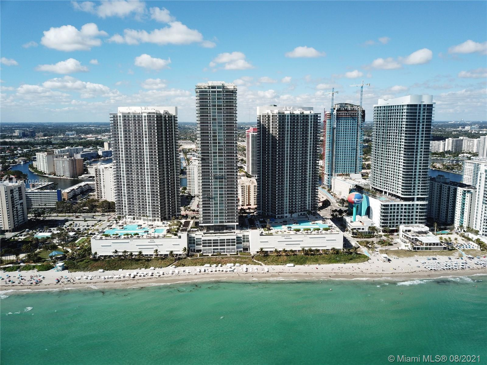 Designer remodeled condo with infinity south east views, corner wrap around balcony with sunrise & s