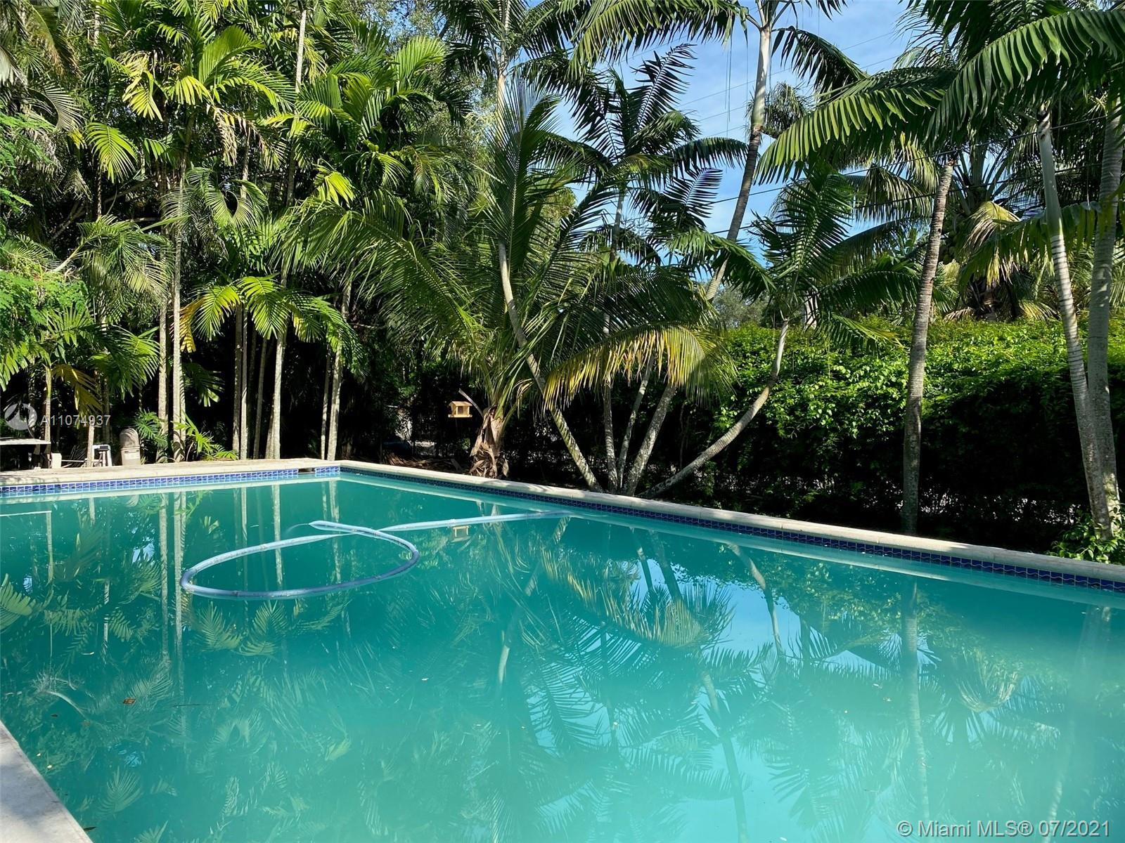 WOW! GRAB THIS BEAUTY and POLISH this GEM! POOL home in NE Miami Shores! True 3 bed & 2 baths PLUS g
