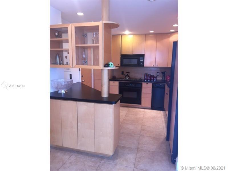 Amazing 2 bedroom ,2 bathroom unit completely remodeled and updated . beautiful tiles throughout the