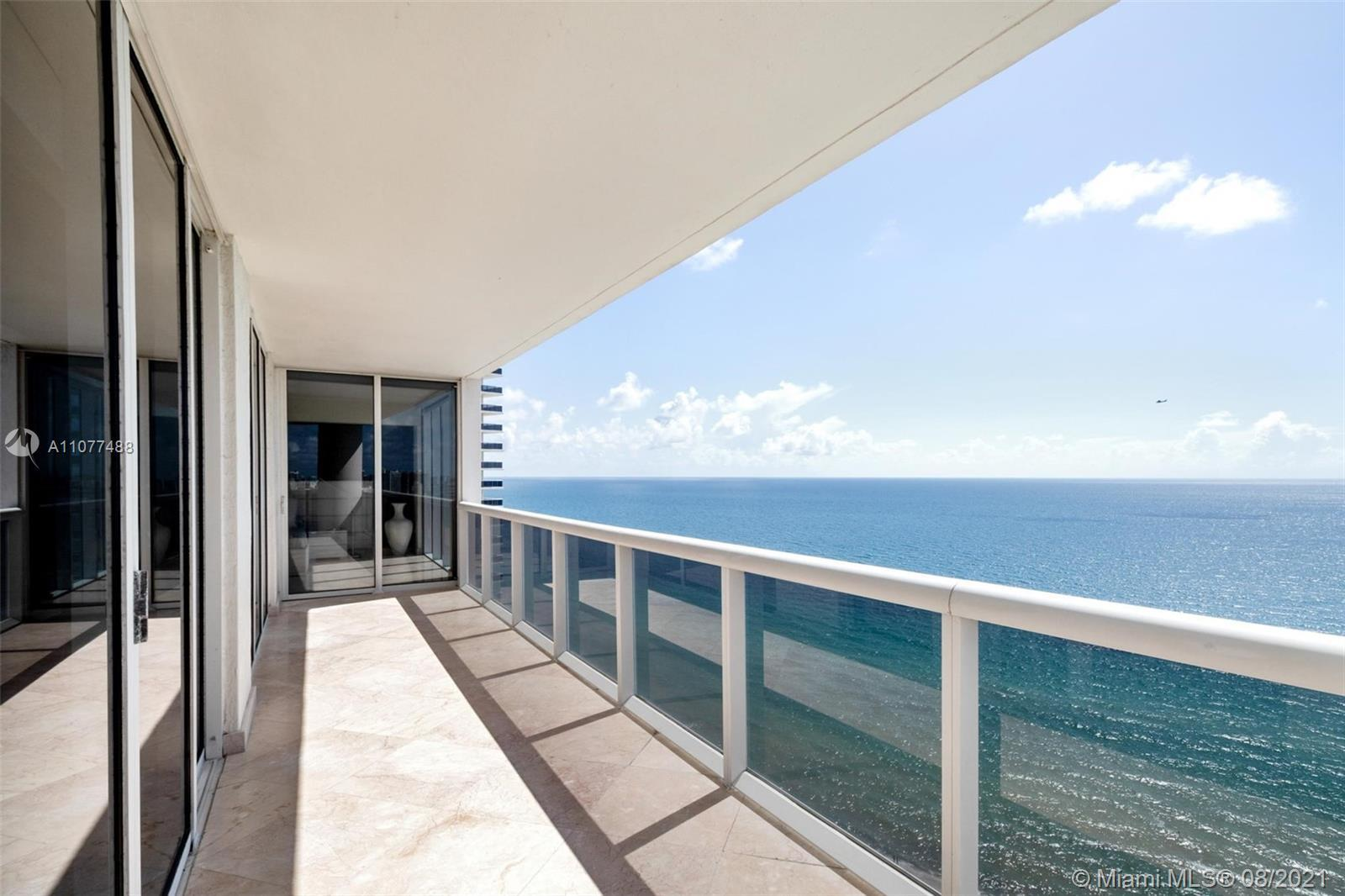 Coveted SE corner with unobstructed direct ocean views that extend all the way to Golden Beach, Sunn