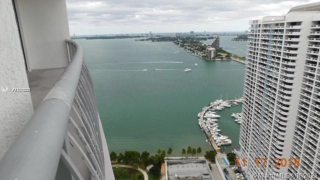 High rise building overlooking the Bay next to waterfront park in trendy neighborhood of edgewater i