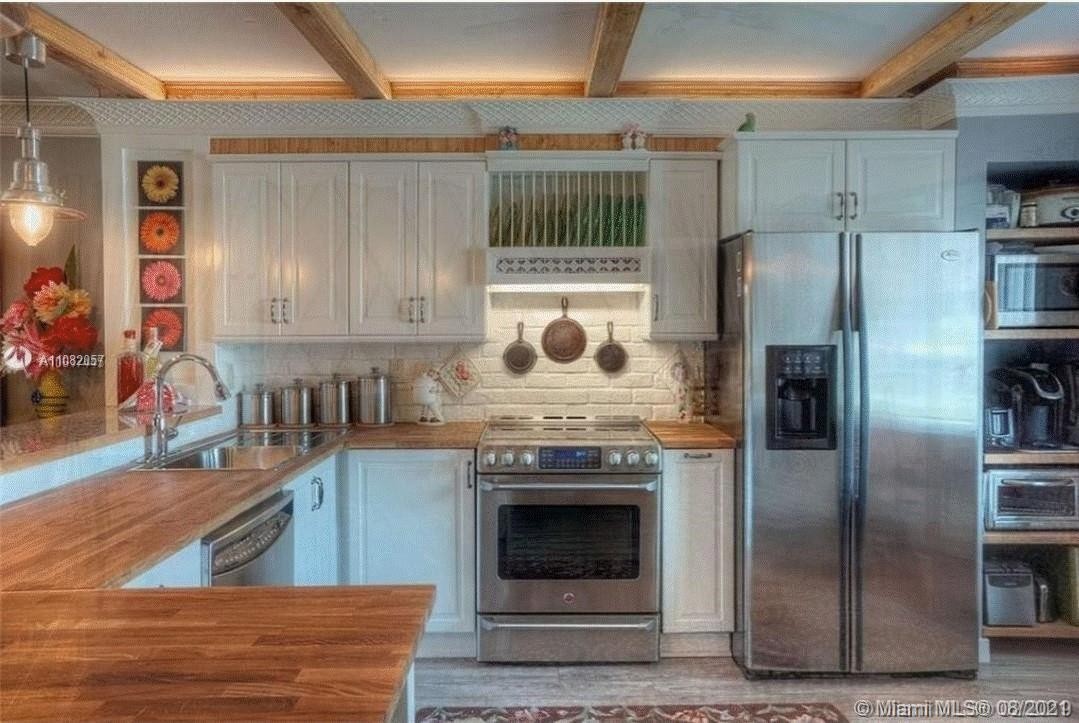 """Your new home on """"The Island"""" at Cypress Bend has been substantially remodeled! Large cook's kitchen"""