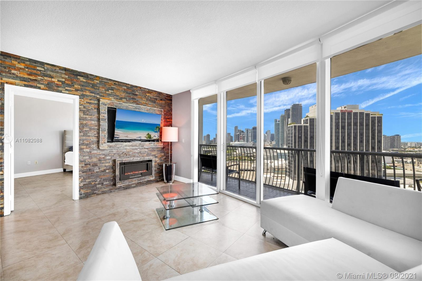 Gorgeous completely renovated 2/2 with Spectacular city and bay views. Open balcony and lots of stor