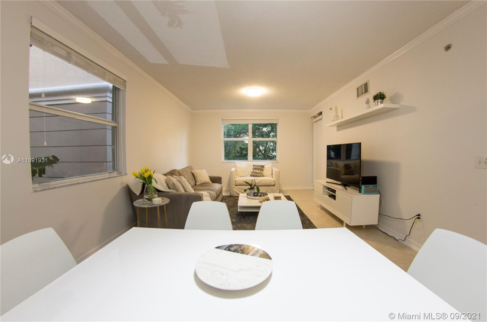 COZY 2 BEDROOM FLORENZA MODEL. UPGRADED WITH TILE FLOORS THROUGHOUT. WASHER AND DRYER INSIDE THE UNI