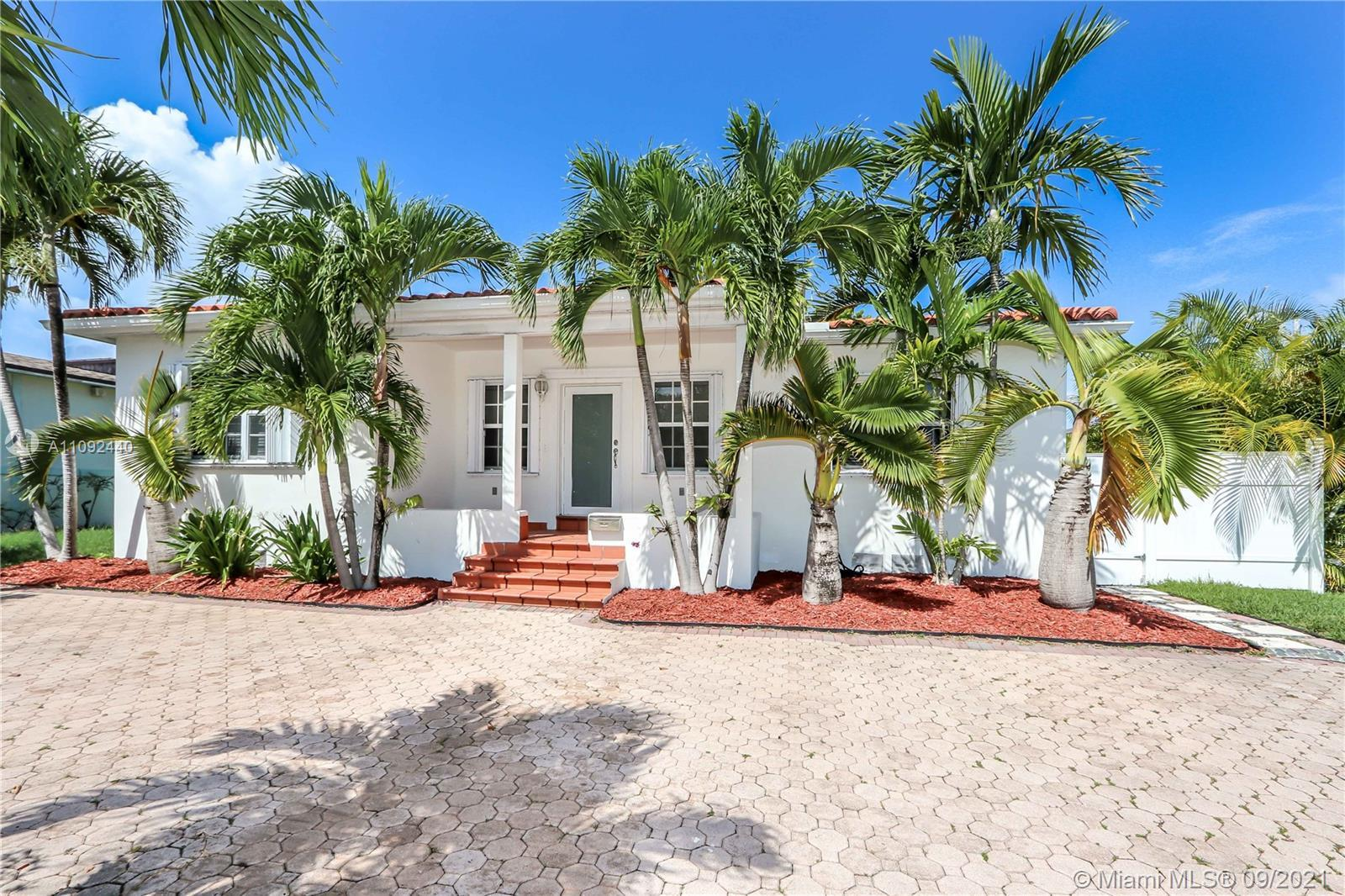 This Miami Beach house is only 1 mile from the beach and surrounded by multi million dollar waterfro