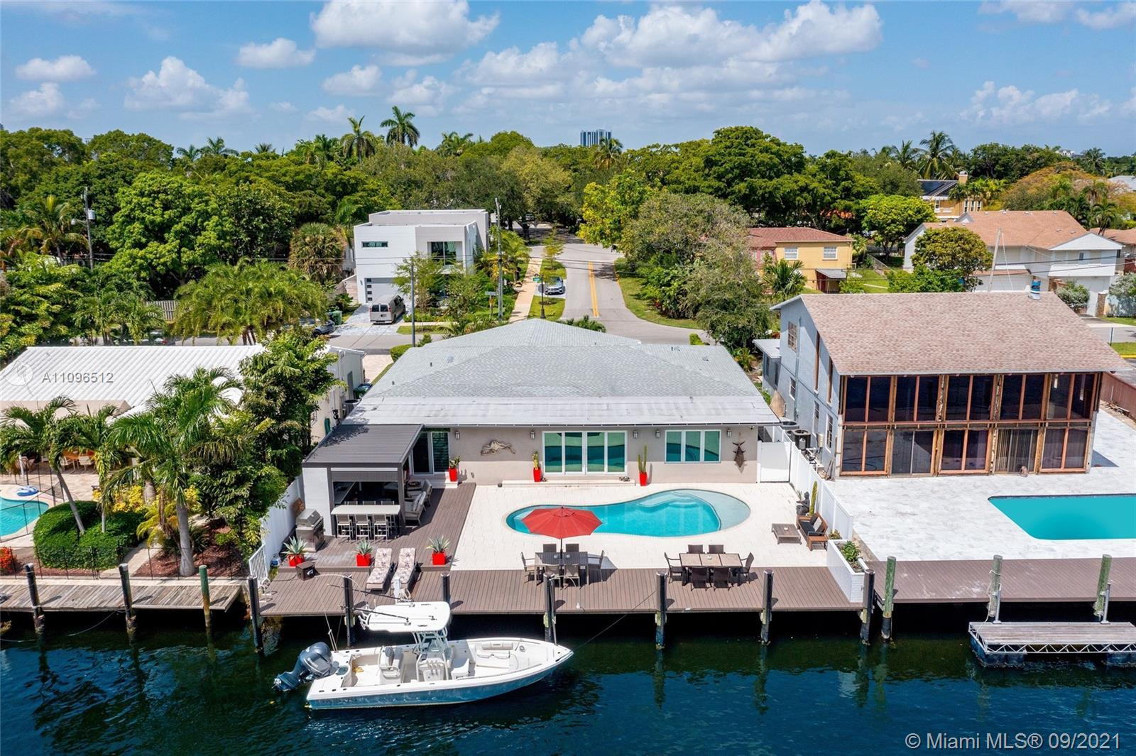 Incredible waterfront property perfectly designed with entertaining in mind. This 3 bedroom, 3 bath