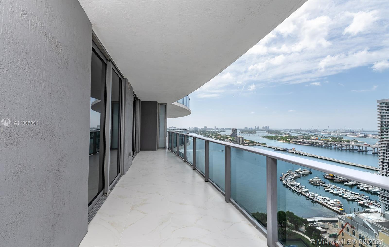 BRIGHT AND SUPER SPACIOUS  3 BED, 3 1/2 BATH UNIT WITH BREATHTAKING VIEWS TO BISCAYNE BAY AT LUXURIO