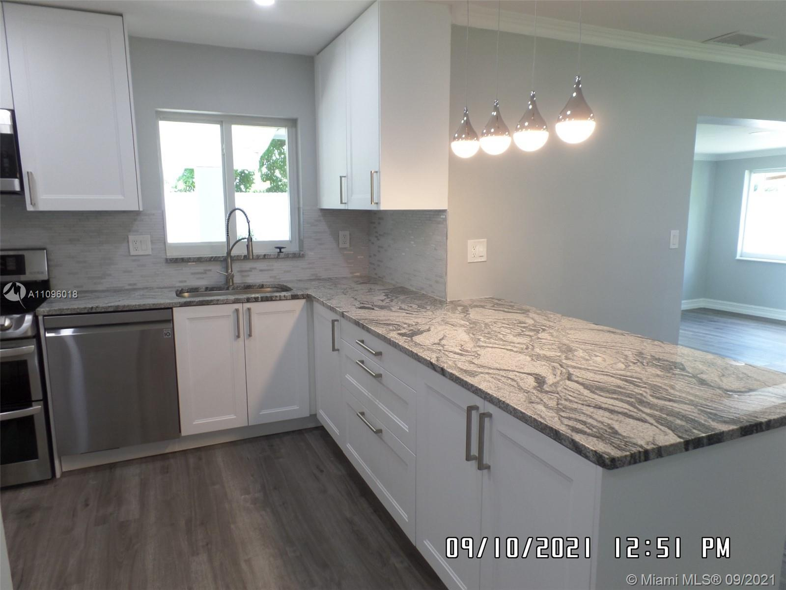 Totally renovated spacious 3/2 in sought after area. Open kitchen with granite countertops and stain