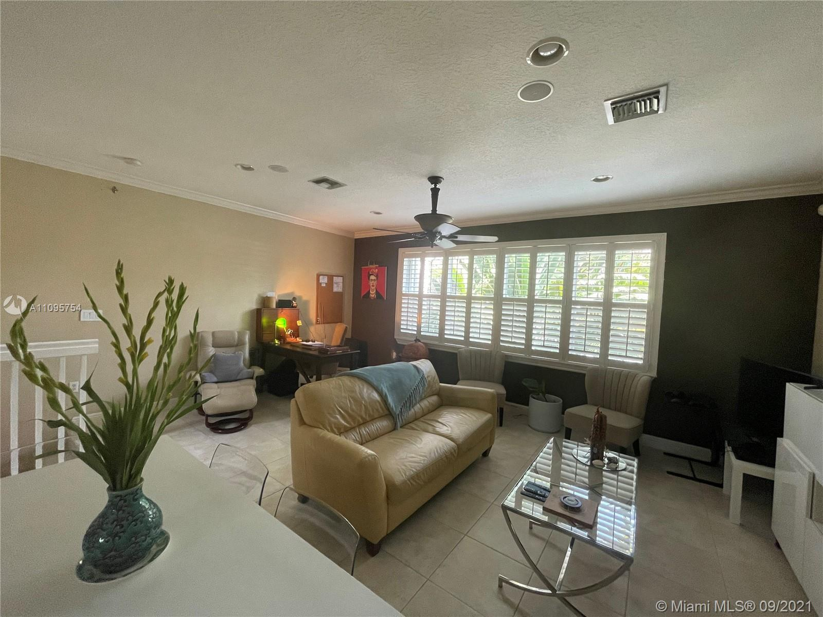 Rarely available 3 bedroom 3 full bath townhouse in Tarpon River. Large tile floors thorough, crown