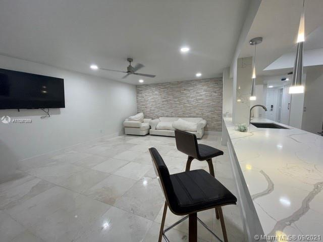 Magnificent condo just 3 minutes from Hollywood beach & boardwalk with reserves in HOA to allow low