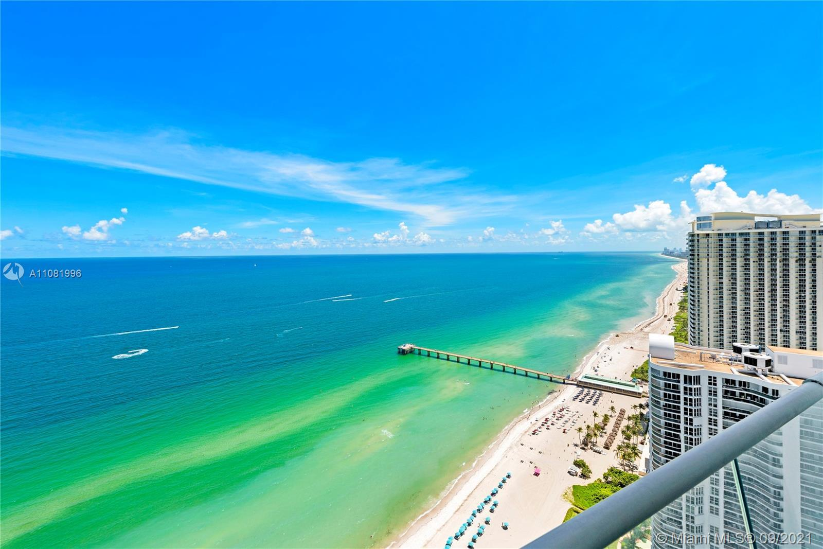 Spectacular flow through residence with breathtaking boasting views of ocean, city, and intracoastal