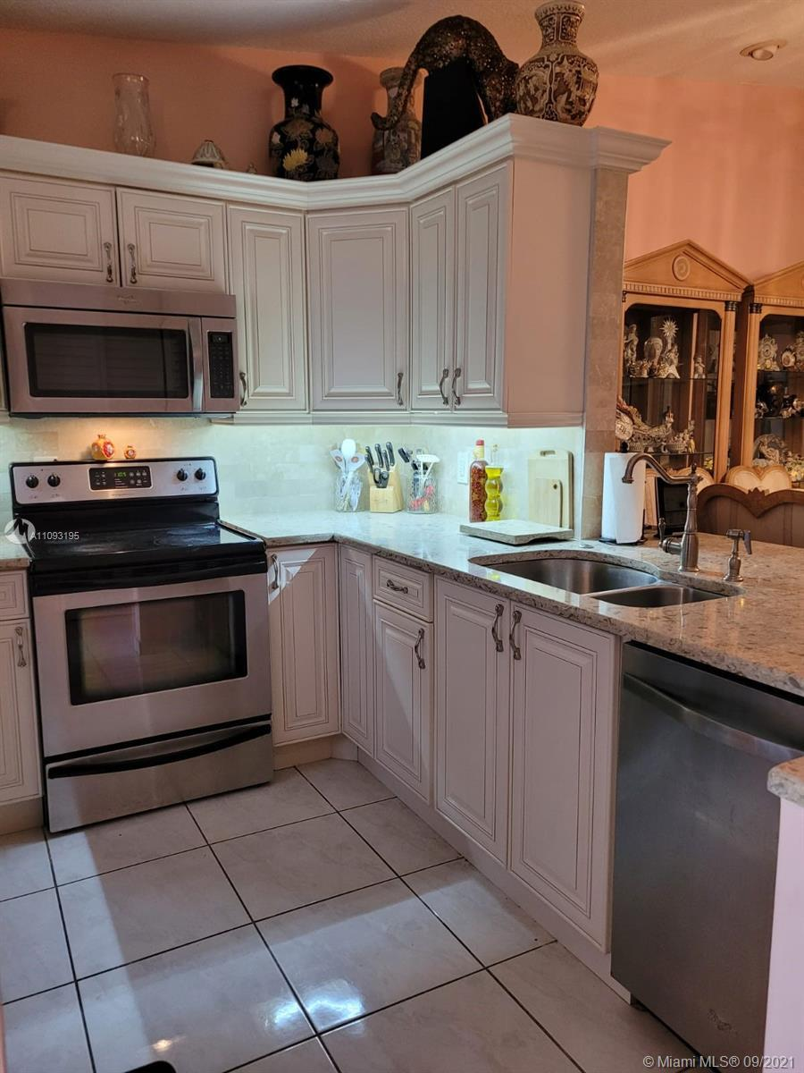 Corner unit townhome located in Boca Raton in the Whisper Walk Community. Townhome recently underwen