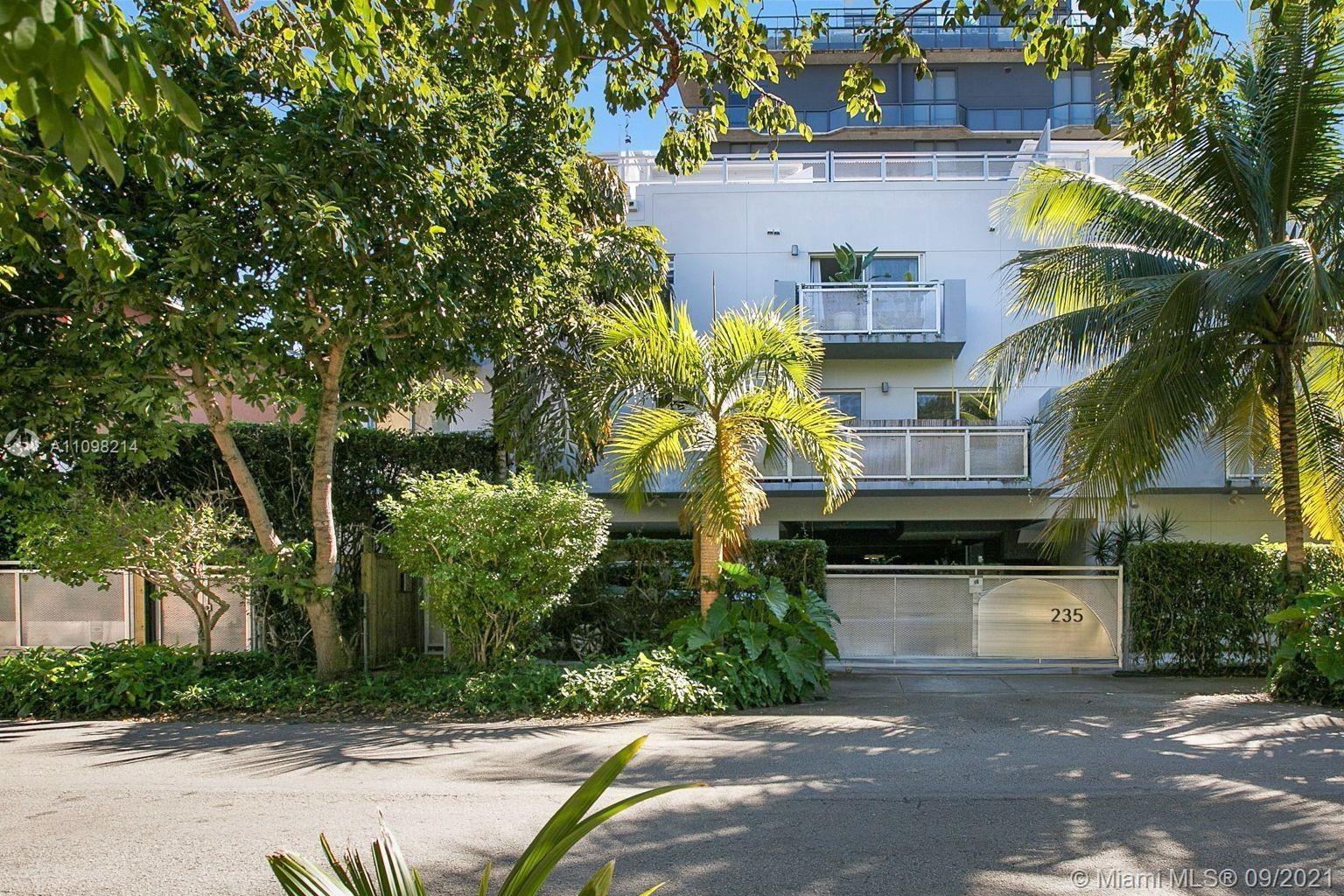 Gorgeous & gated tri-level townhouse with a rooftop terrace, beautiful skyline & tree canopy views.