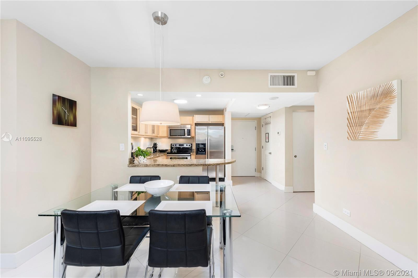 Large 1 bedroom condo with full bath, kitchen, balcony, and impact windows in the oceanfront Roney P