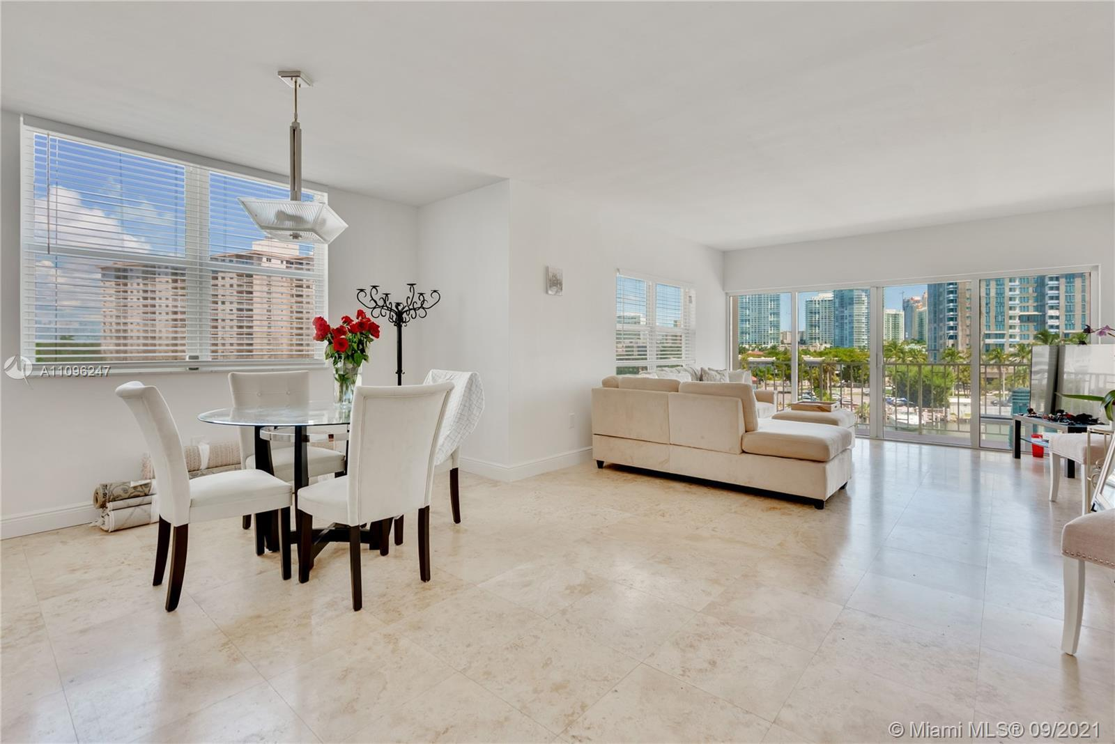 Spacious corner unit at Arlen House in Sunny Isles overlooking the waterways. The unit features 2 be