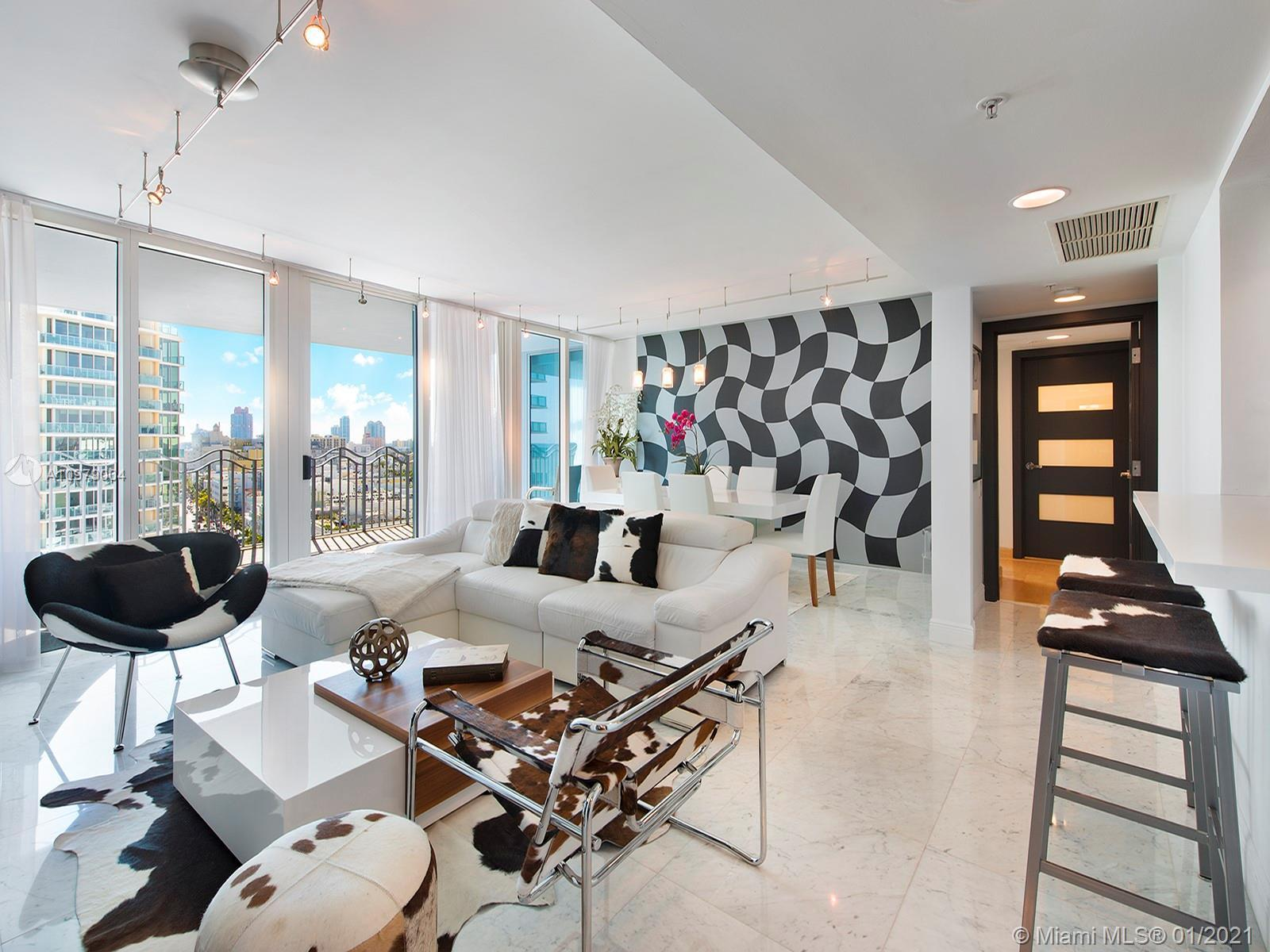 Beautifully renovated South exposure, carrera marble flooring and ocean & city views from every room