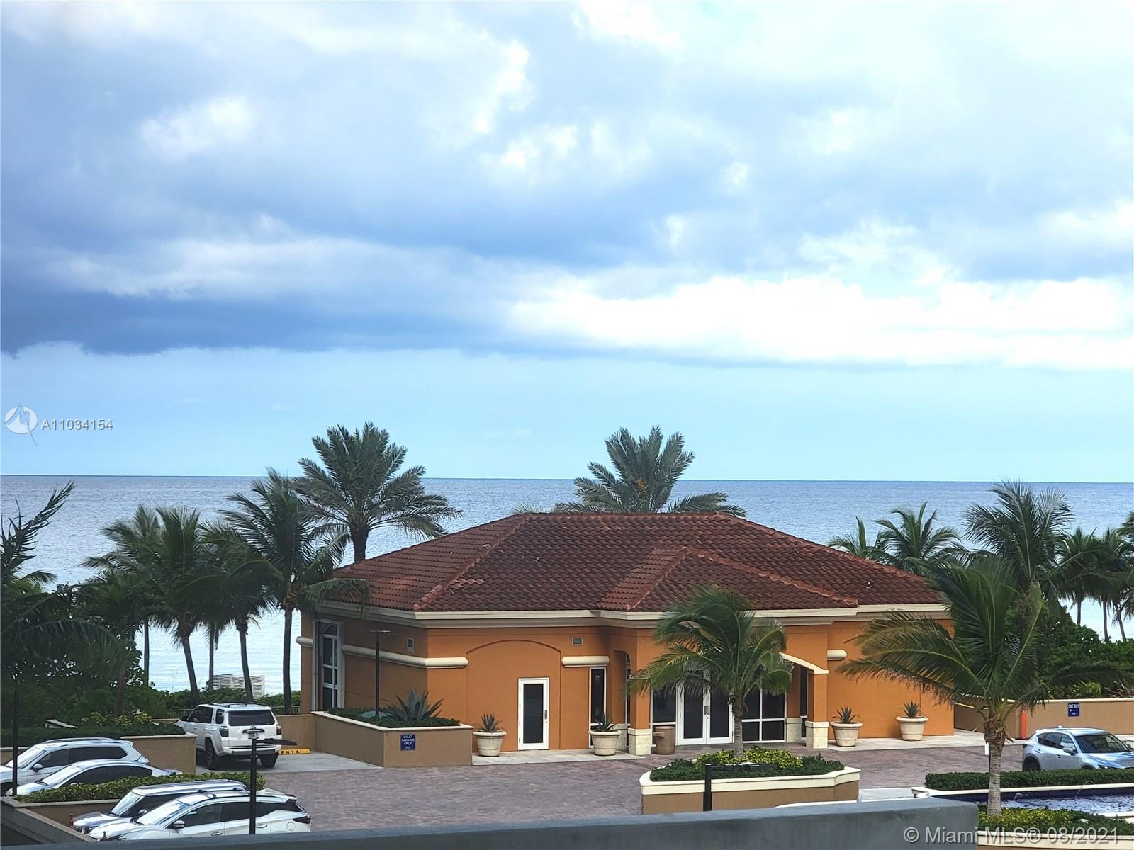 BEST PRICED BEACHFRONT TWO BEDROOM CONDO WITH  PARTIAL OCEAN VIEWS, LARGE OPEN SOUTHEAST BALCONY.