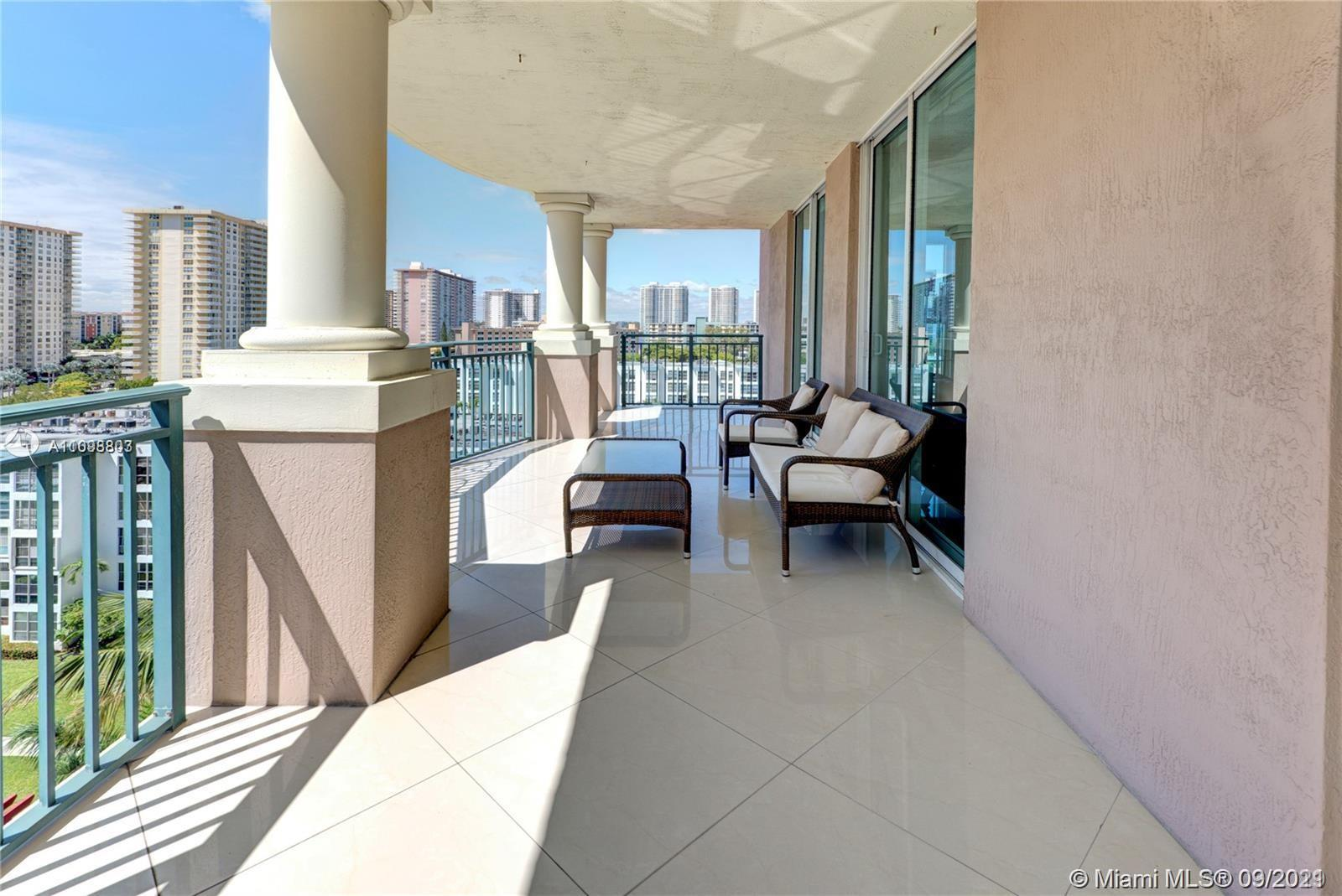 AMAZING TURN KEY UNIT BOASTING A LARGE PATIO WITH OCEAN VIEW, SHORT WALK TO THE BEACH, SHOPPING AND