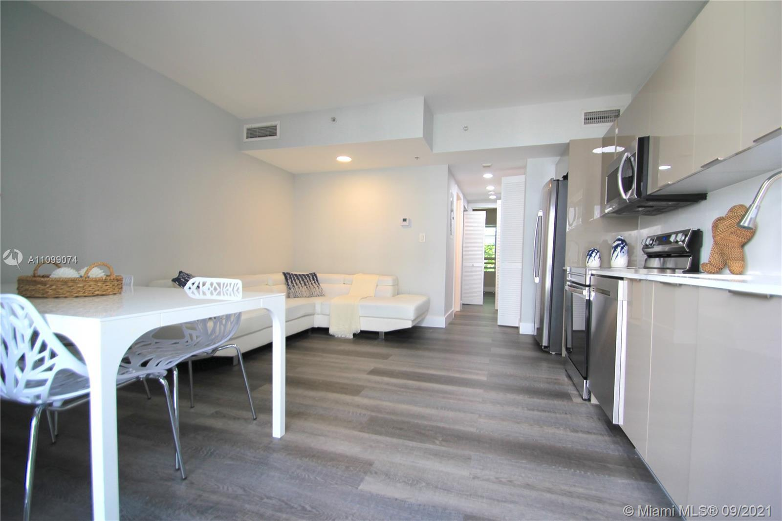 Enjoy your private courtyard entrance to this 1st floor, flow-through garden apartment, by famed Art