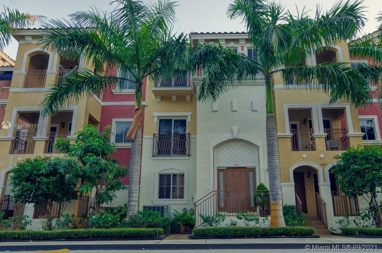 Rarely available, updated, three-story turnkey townhome, located in the cozy gated Coastal Bay commu
