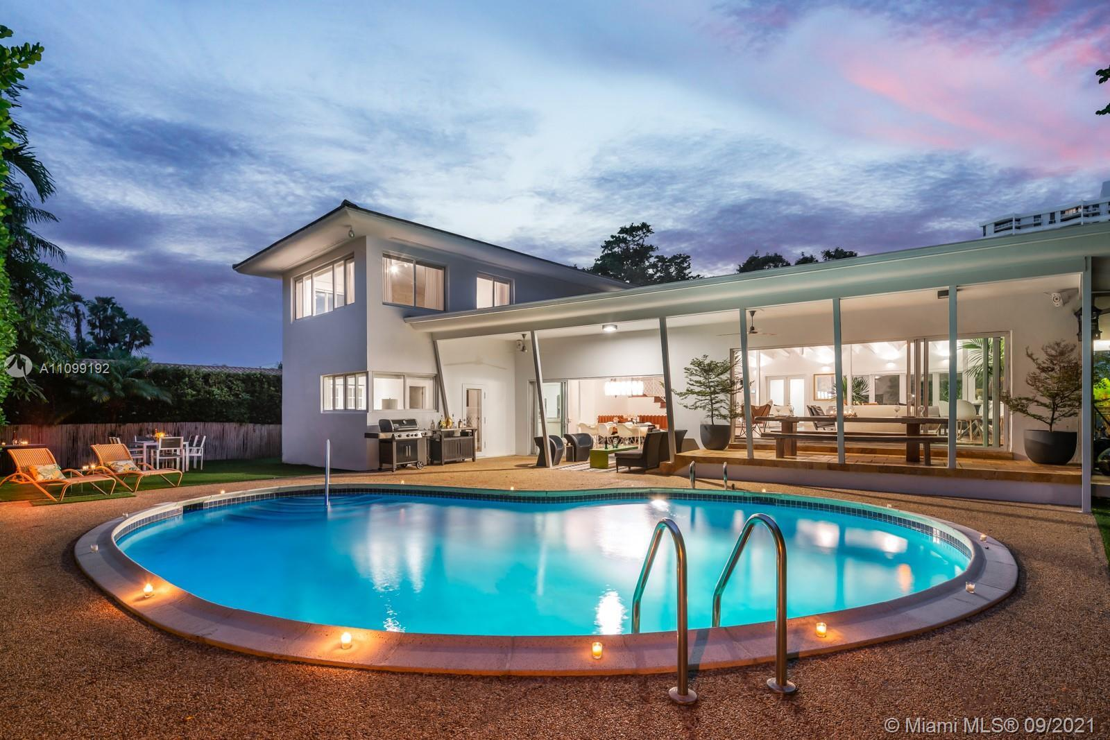 Life is extraordinaire at The Nordinaire! Be wowed by this tri-level Mid-Century trophy pool home, a