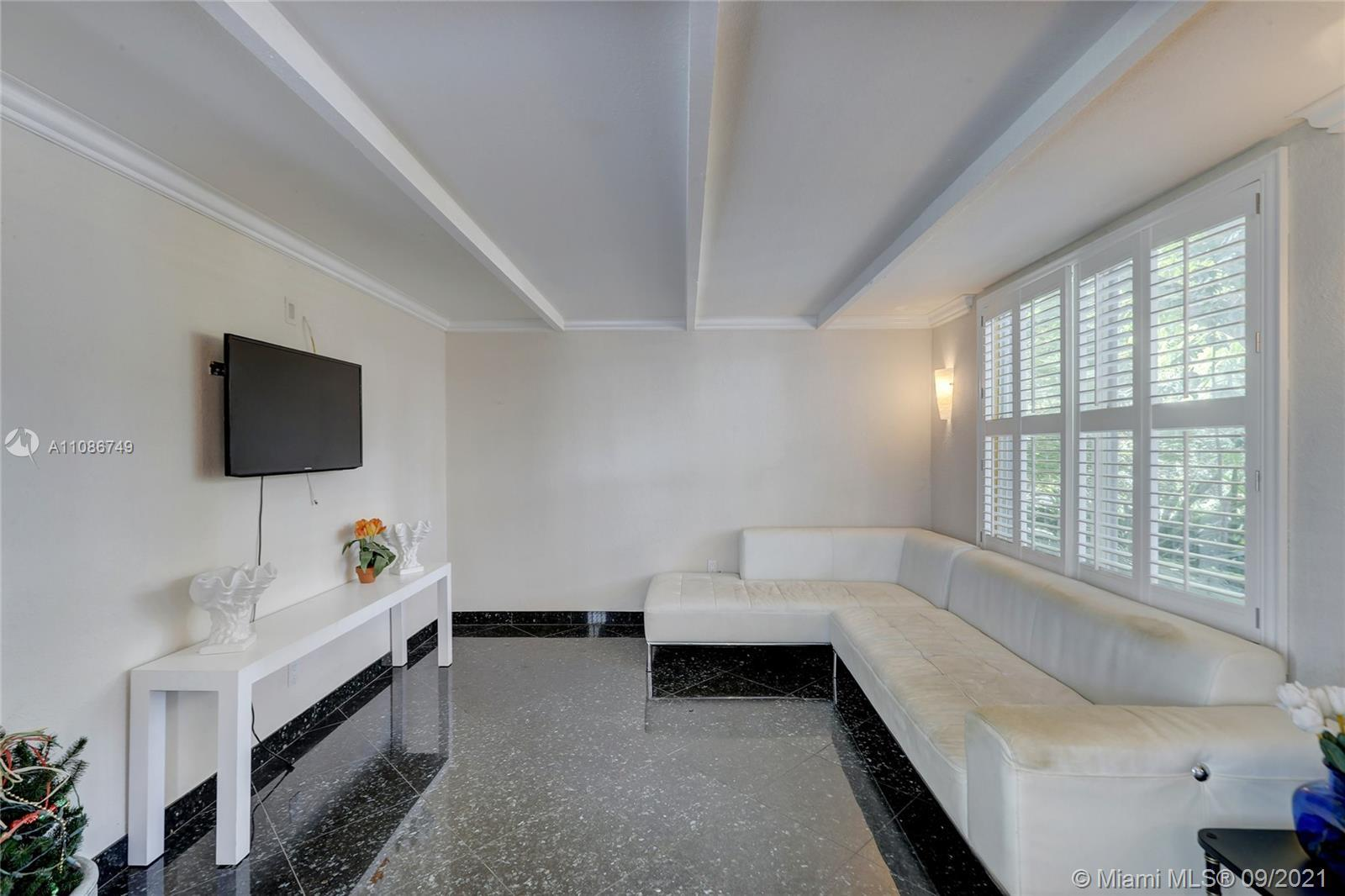 Large corner Mid Century Modern home in Wilton Manors! Freshly painted living areas, updated kitchen