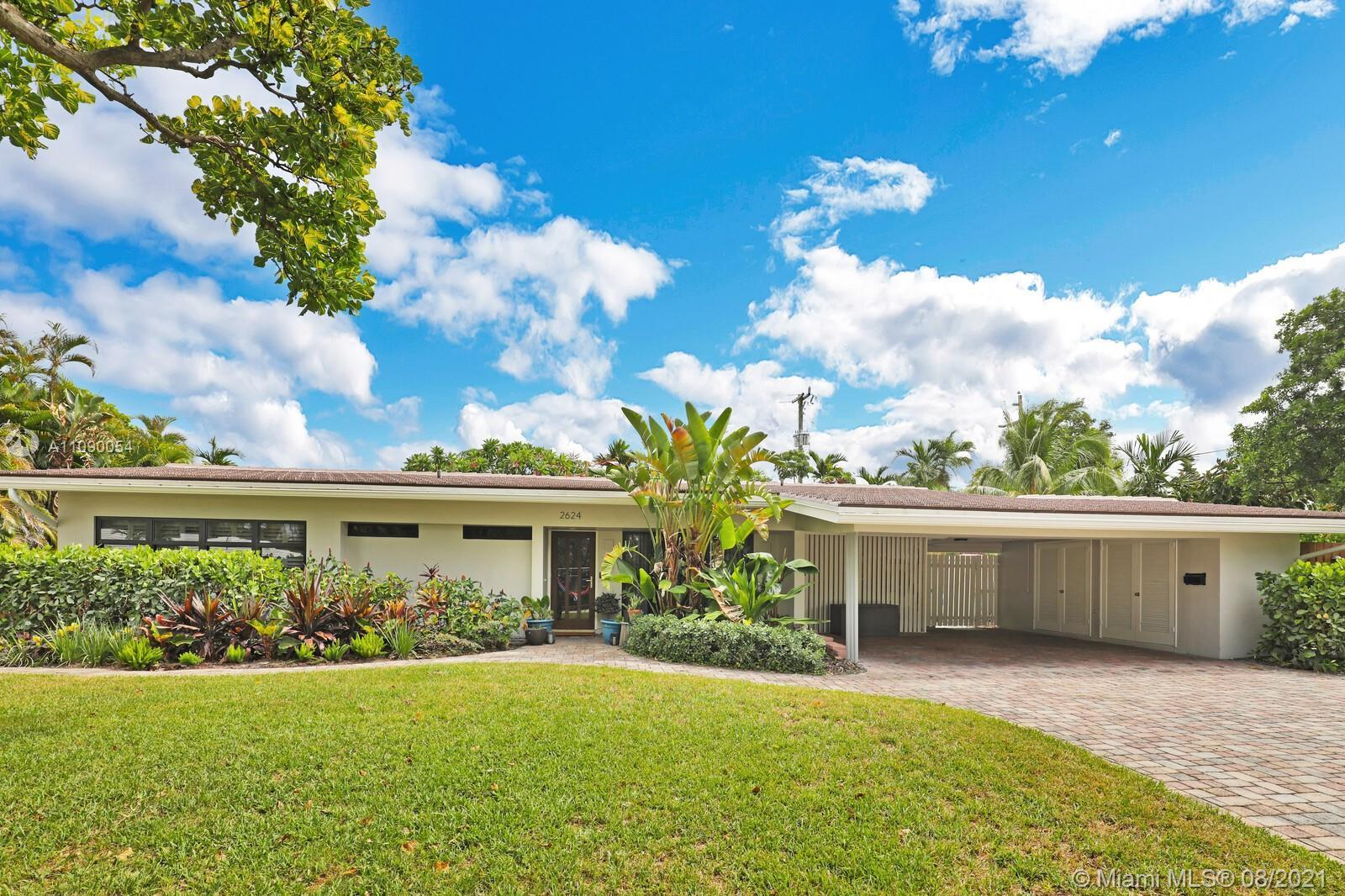 Fabulous opportunity to own a 3 bedroom, 2 bath with pool in the heart of Coral Ridge!  The vaulted,