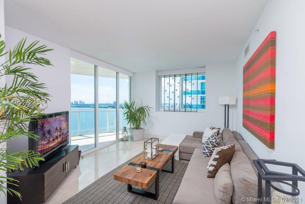 This amazing corner UNIT COMES W/1 PARKING SPACE located on the first floor parking level, within st