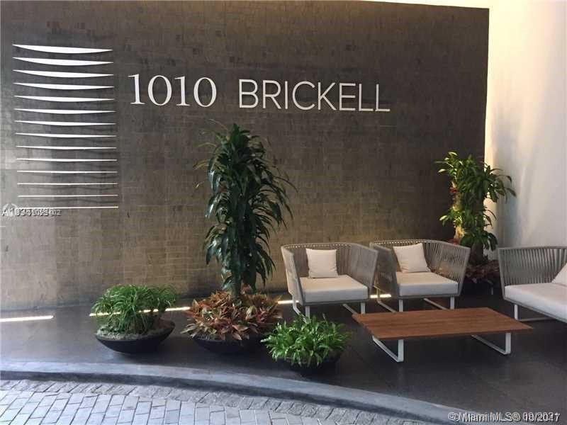 Spectacular unit at iconic 1010 Brickell Condo. Unit features 2 beds, 3 full baths + den, glass encl