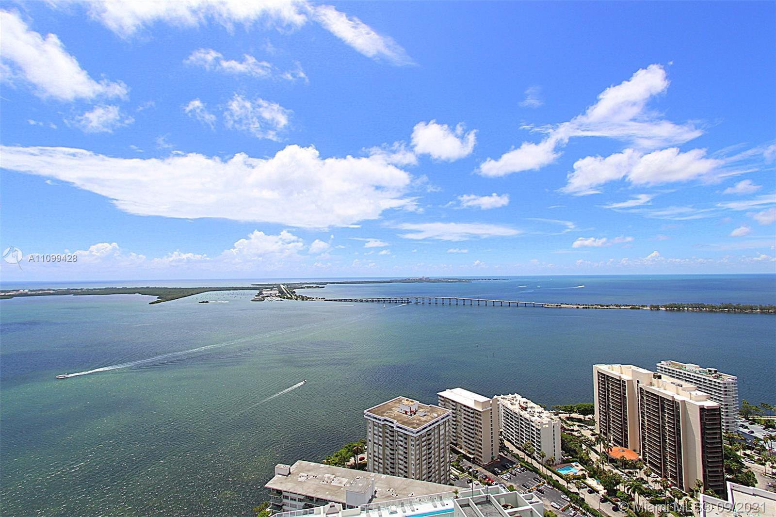Sweeping & unobstructed water views from this 43rd floor penthouse located in the Brickell House Con