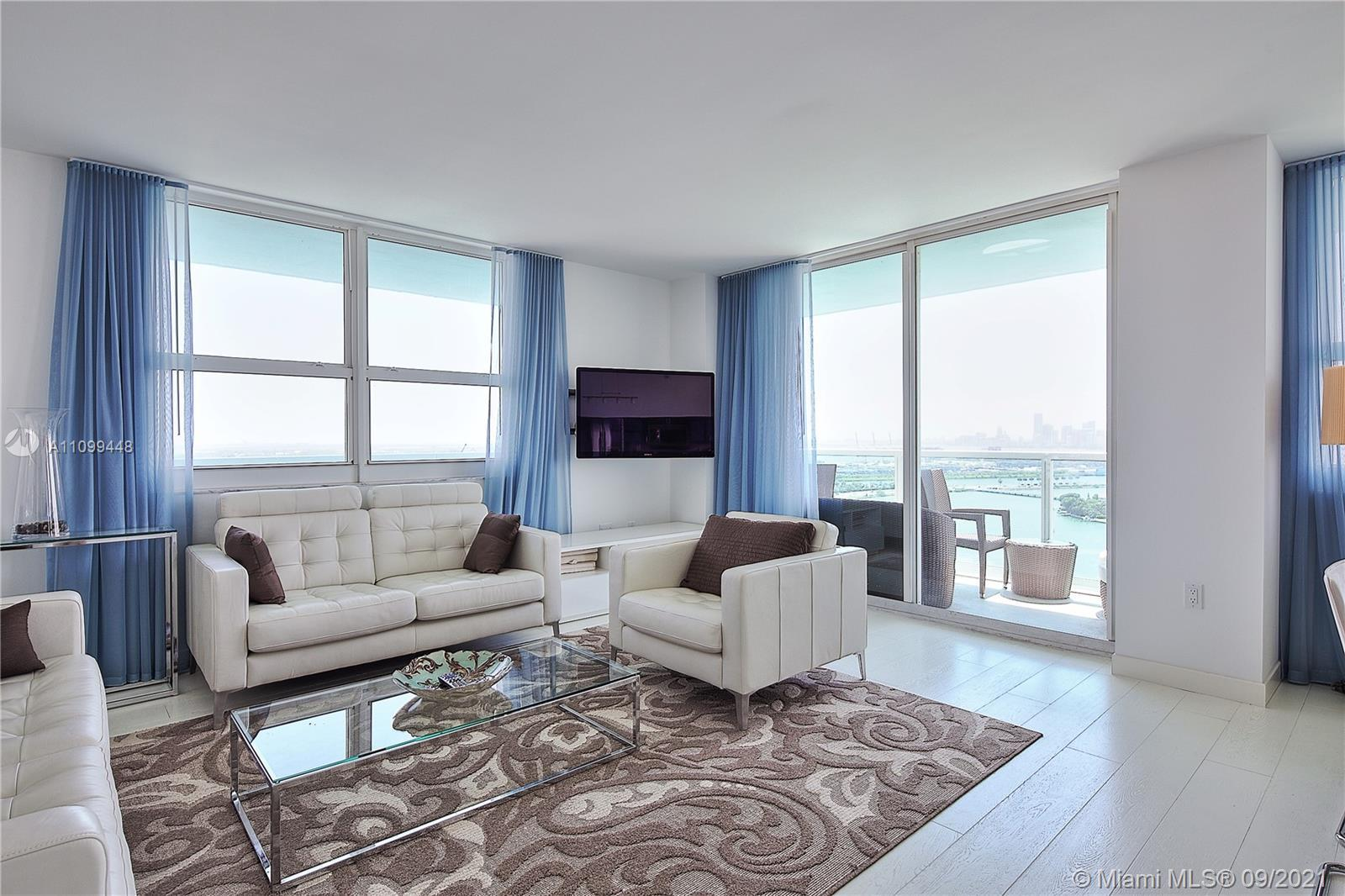 Stunning Corner Unit with direct view to the bay and Ocean. Night view is breathtaking. Water view